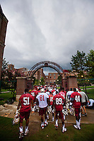 TALLAHASSEE, FL 8/6/12-FSU080612 CH-Florida State football players leave the field for cover as lightning strikes delay the first day of fall football practice Aug. 6 in Tallahassee. .COLIN HACKLEY PHOTO