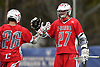George Wichelns #27 of Connetquot, right, congratulates teammate Tyler Cordes #26 after he scored a goal in a Suffolk County varsity boys lacrosse game against host Huntington High School on Friday, April 7, 2017. Connetquot rallied from a 12-10 deficit early in the fourth quarter to win 15-14.