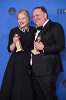 After winning the category of BEST PERFORMANCE BY AN ACTRESS IN A TELEVISION SERIES &ndash; DRAMA for her role in &quot;The Handmaid's Tale,&quot; actress Elisabeth Moss posed backstage with Writer/producer Bruce Miller who accepted the award For BEST TELEVISION SERIES &ndash; DRAMA, for &quot;The Handmaid's Tale&quot; (HULU) at the 75th Annual Golden Globe Awards at the Beverly Hilton in Beverly Hills, CA on Sunday, January 7, 2018.<br /> *Editorial Use Only*<br /> CAP/PLF/HFPA<br /> &copy;HFPA/PLF/Capital Pictures