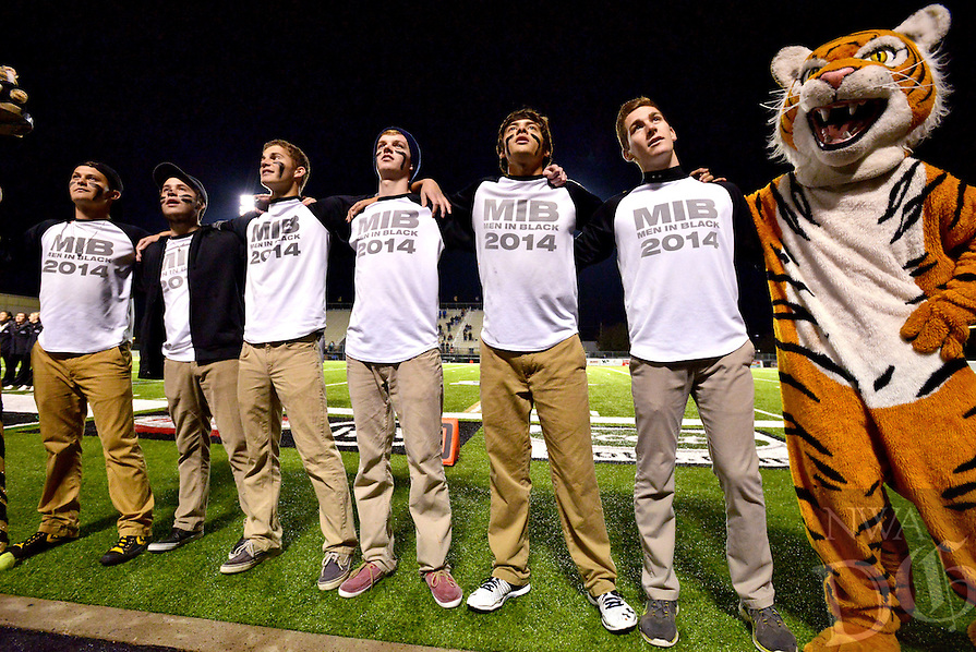 STAFF PHOTO BEN GOFF  @NWABenGoff -- 11/21/14 The Bentonville Men in Black lead the student section in the school song before the class 7A playoffs game in Bentonville's Tiger Stadium on Friday Nov. 21, 2014.