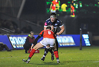 Saracens No 9 Richard Wigglesworth tackles Sale Sharks Cameron Neild during the European Rugby Champions Cup match between Sale Sharks and Saracens at AJ Bell Stadium, Salford, England on 18 December 2016. Photo by Paul Bell.