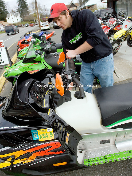THOMASTON, CT. 05 November 2012-110512SV04-Nick Ferguson of Roost Power Sports gets the snowmobiles ready for customers at the shop in Thomaston Monday. Ferguson said people are jumping from quads to sleds fast this year and with a possible nor'easter headed this way everybody is thinking of snow..Steven Valenti Republican-American