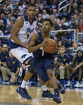 Akron guard  Loren Cristian Jackson (1) drives against Nevada's Tre'Shawn Thurman (0) in the second half of an NCAA college basketball game in Reno, Nev., Saturday, Dec. 22, 2018. (AP Photo/Tom R. Smedes)