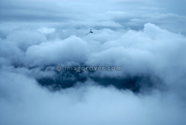 Brazil, Rio de Janeiro: Rio's iconic Christo Redentor statue on Corcovado is peeking through the clouds that cover Rio's city centre. --- No signed releases available.