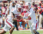North Carolina State quarterback Ryan Finley (15) hands off to running back Nyheim Hines in the first half of an NCAA college football game against Florida State in Tallahassee, Fla., Saturday, Sept. 23, 2017.  (AP Photo/Mark Wallheiser)