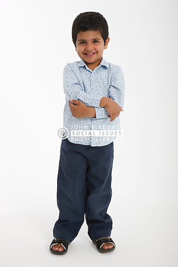 Asian boy in studio portrait