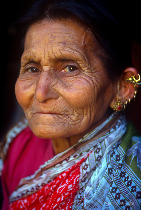Woman with many earings, Chainpur, Nepal.