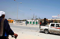 23.04.11 A bullet can be seen leaving the barrel as Militia fighting against Col Gaddafi fire into a building where Gaddafi's army are believed to be on Benghazi Street in Misrata, Libya.