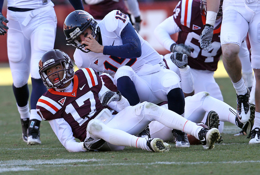 Nov 27, 2010; Charlottesville, VA, USA;  Virginia Tech Hokies cornerback Kyle Fuller (17)and Virginia Cavaliers quarterback Ross Metheny (15) during the game at Lane Stadium. Virginia Tech won 37-7. Mandatory Credit: Andrew Shurtleff