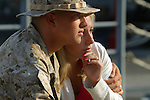 A young Marine and his wife embrace as the time draws near for the departure of the 11th Marine Expedition Unit from the San Diego Naval Station aboard the ships of the 3rd Expeditionary Strike Group on a schecduled seven month deployment to Iraq. The 11th MEU - comprised of approximately 2,200 Marines - will arrive in Iraq in mid-July to replace elements of the 1st Armored Division which has been in Iraq for nearly a year-and-a-half.
