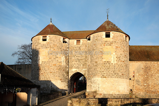 The gatehouse with its 2 entry towers on the East wall of the Chateau de Dourdan, built 1220-22 by Guillaume de Flamenville under Philippe Auguste, replacing an earlier wooden structure, Dourdan, Hurepoix, Essonne, France. The castle is built on a square plan, with towers along the sides, at 3 of the corners and an isolated donjon at the 4th, and is surrounded by a dry moat. From 1672-1852 it became a prison, and now houses a history museum. The castle became an Historical Monument in 1964. Picture by Manuel Cohen