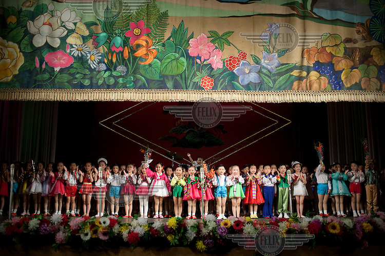 Young children aged 5 and 6 perform in a song and dance propaganda show at the Schoolchildren's Palace in Pyongyang.