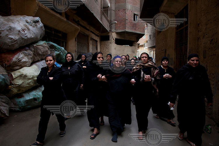 Family of coptic killed by egyptian army go to the  church  for the  funeral in mokattam  10th marz 2011. 11 christians was  shooted dead  by egyptian  army during the  clashes between muslims radical and christians  in Moqattam quarter , Cairo.