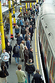 Passengers on the platform of Farringdon underground station, London.
