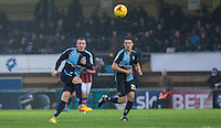 Garry Thompson of Wycombe Wanderers plays the ball forward during the Sky Bet League 2 match between Wycombe Wanderers and Morecambe at Adams Park, High Wycombe, England on 2 January 2016. Photo by Andy Rowland / PRiME Media Images