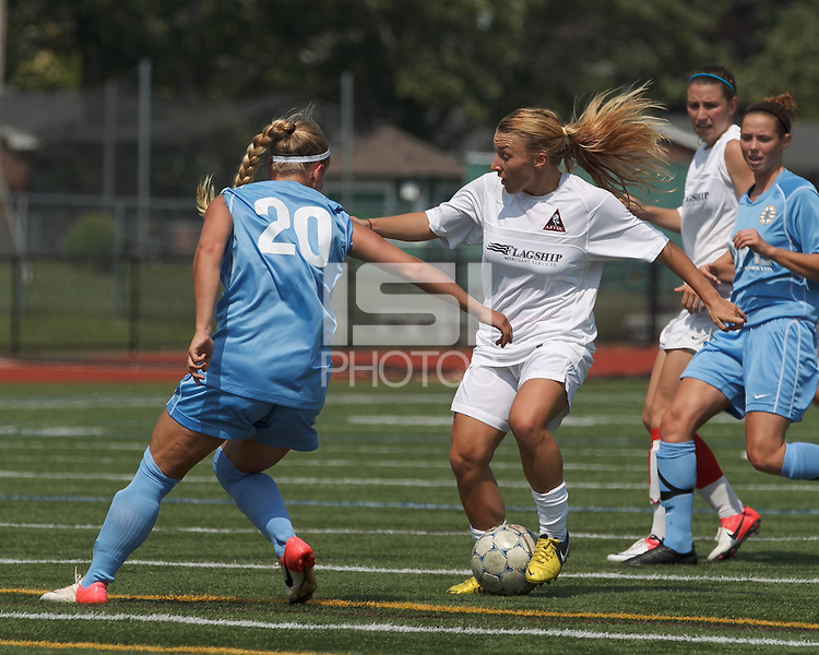 Boston Aztec midfielder Riley Houle (22) dribbles. In a Women's Premier Soccer League (WPSL) match, Boston Aztec (white) defeated Seacoast United Mariners (blue), 2-1, at North Reading High School Stadium on Arthur J. Kenney Athletic Field on on June 23, 2013. Due to injuries through the season, Seacoast United Mariners could only field 10 players.