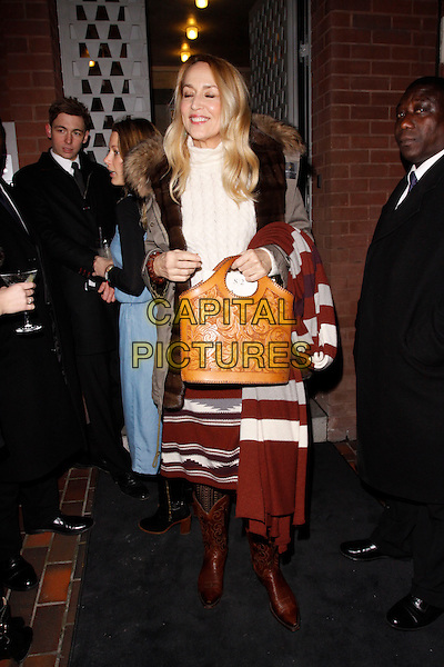 LONDON, ENGLAND - FEBRUARY 04 :  Jerry Hall leaves the Ron Gorchov - VIP private view at Sotheby's S2 Gallery on February 04, 2015 in London, England.<br /> CAP/AH<br /> &copy;Adam Houghton/Capital Pictures