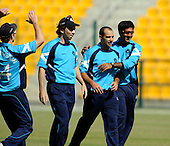 A celebration smiile from Scotland's Kyle Coetzer (2nd right), taking three wickets in theT20 World Cup Qualifying match against Afghanistan in Abu Dhabi, sadly to no avail as Scotland lost - Picture by Donald MacLeod 10.02.10