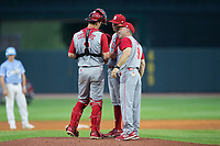 North Carolina State Wolfpack head coach Elliott Avent (9) has a meeting on the mound with catcher Andy Cosgrove (2) and relief pitcher Austin Staley (20) during the game against the North Carolina Tar Heels in Game Twelve of the 2017 ACC Baseball Championship at Louisville Slugger Field on May 26, 2017 in Louisville, Kentucky.  The Tar Heels defeated the Wolfpack 12-4 to advance to the semi-finals.  (Brian Westerholt/Four Seam Images)