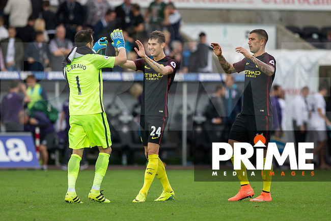 Claudio Bravo of Manchester City celebrates his side's win with John Stones and Aleksandar Kolarov at full time of the EPL - Premier League match between Swansea City and Manchester City at the Liberty Stadium, Swansea, Wales on 24 September 2016. Photo by Mark  Hawkins.