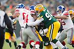 Green Bay Packers defensive lineman B.J. Raji (90) tackles New York Giants running back Ahmad Bradshaw (44) during an NFL divisional playoff football game on January 15, 2012 in Green Bay, Wisconsin. The Giants won 37-20. (AP Photo/David Stluka)