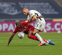 Swansea City's Mike van der Hoorn (right) battles for possession with Bristol City's Benik Afobe (left) <br /> <br /> Photographer David Horton/CameraSport<br /> <br /> The EFL Sky Bet Championship - Swansea City v Bristol City- Saturday 18th July 2020 - Liberty Stadium - Swansea<br /> <br /> World Copyright © 2019 CameraSport. All rights reserved. 43 Linden Ave. Countesthorpe. Leicester. England. LE8 5PG - Tel: +44 (0) 116 277 4147 - admin@camerasport.com - www.camerasport.com
