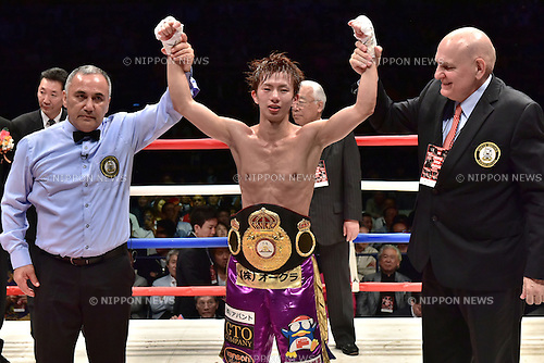 Ryoichi Taguchi (JPN),<br /> MAY 6, 2015 - Boxing :<br /> Ryoichi Taguchi of Japan has his arms raised by referee Ferlin Marsh and WBA supervisor Renzo Bagnariol as he celebrates with his champion belt after winning the WBA light flyweight title bout at Ota-City General Gymnasium in Tokyo, Japan. (Photo by Hiroaki Yamaguchi/AFLO)
