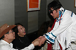 May 19, 2010 - Tokyo, Japan - 'Elvis Alan Kizusuley' talks to a fan at Live House STAGE-1 in Tokyo, Japan, on May 19, 2010. The 68-year-old Japanese rock 'n roll & country singer started singing Elvis Presley songs in 1957. He continues to put on high-energy shows in Japan several times a year.