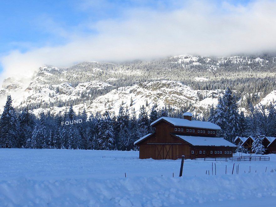A barn stands out against the snow on a beautiful winter day in the Methow Valley, Washington.