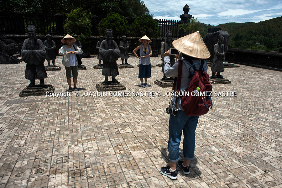 A group of Vietnamese visitors are taking some photos next to the sculptures that adorn the imperial tomb of KHAI DINH in the city of Hue (Vietnam)<br /> HUE-VIETNAM