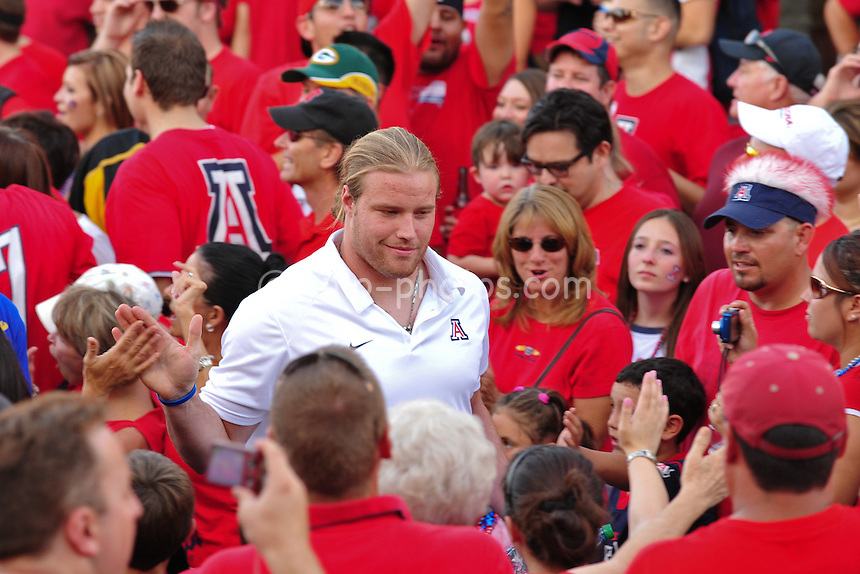 "Sept 18, 2010; Tucson, AZ, USA; Arizona Wildcats defensive end Brooks Reed walks through a crowd of fans during ""Wildcat Walk"" prior to a game against the Iowa Hawkeyes at Arizona Stadium."