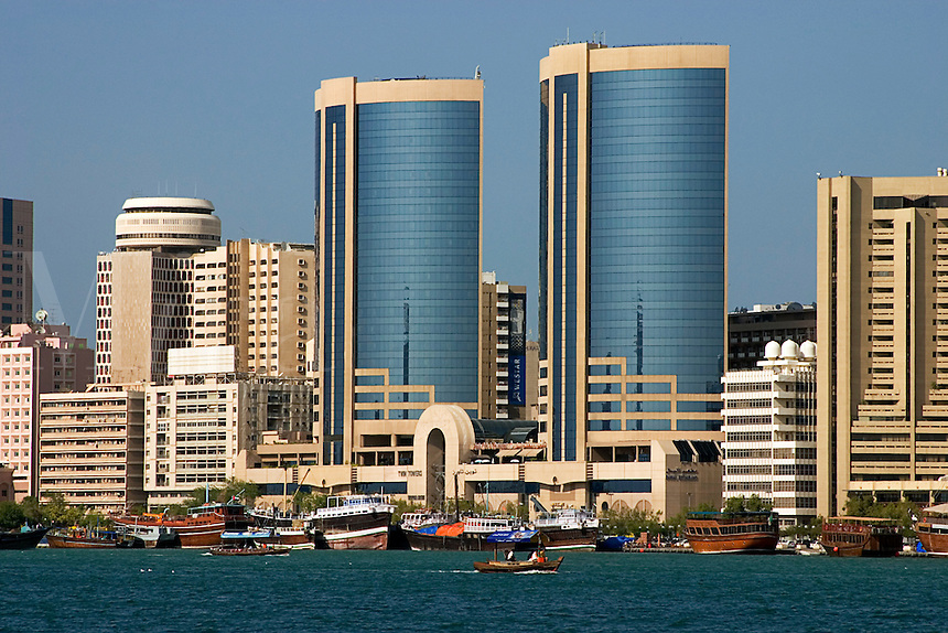 Dubai, United Arab Emirates. Dubai Creek and commercial waterfront offices, hotels, etc. Twin Towers..