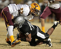 112410202tk  5a1footsemis1204  12/3/10- Mountain Pointe's Martin Moriel tackles Hamilton's Kendyl Taylor (CQ)  during the first half of Friday's game at Chandler High School. (Pat Shannahan/ The Arizona Republic)