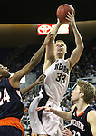 Nevada's Kevin Panzer shoots over Bucknell defenders Ryan Hill and Ben Brackney during a second round NIT college basketball game in Reno, Nev. , on Sunday, March 18, 2012. Nevada won 75-67..Photo by Cathleen Allison