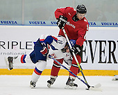 Julius Sinkovic (Val-d'Or - Slovakia) and Robin Grossmann (Kloten Flyers - Switzerland) battle for the puck. The Suisse defeated Slovakia 2-1 in a 2007 World Juniors match on January 2, 2007, at FM Mattson Arena in Mora, Sweden.