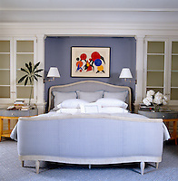 A drawing by Calder hangs above the large upholstered bed in the master bedroom
