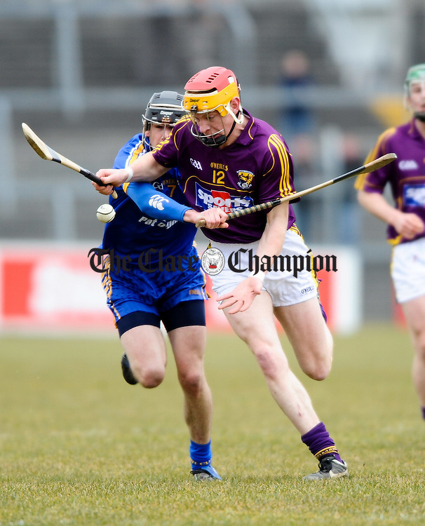 Clare's Patrick Donnelan tackles Wexford's Andrew Shore during their Division 2 National League game at Cusack Park. Photograph by John Kelly.