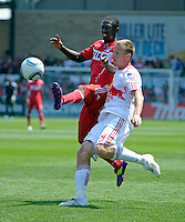 Chicago midfielder Patrick Nyarko (14) battles for the ball with New York defender Jan Gunnar Solli (8).  The Chicago Fire tied the New York Red Bulls 1-1 at Toyota Park in Bridgeview, IL on June 26, 2011.