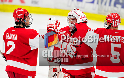 9 January 2011: Boston University Terrier goaltender Kieran Millan, a Junior from Edmonton, Alberta, is congratulated by teammates Ryan Ruikka and David Warsofsky after a game against the University of Vermont Catamounts at Gutterson Fieldhouse in Burlington, Vermont. The Terriers defeated the Catamounts 4-2 in Hockey East play. Mandatory Credit: Ed Wolfstein Photo