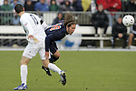 13 December 2009: Virginia's Ari Dimas (19) and Akron's Ben Zemanski (13). The University of Virginia Cavaliers defeated the University of Akron Zips 3-2 in penalty kicks following a 0-0 overtime tie at WakeMed Soccer Stadium in Cary, North Carolina in the NCAA Division I Men's College Cup Championship game.