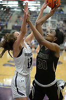 Bentonville's Maryam Dauda (right) takes a shot in the lane Friday, Jan. 17, 2020, as Fayetteville's Sasha Goforth defends during the second half of play in Bulldog Arena in Fayetteville. Visit nwaonline.com/prepbball/ for a gallery from the games.<br /> (NWA Democrat-Gazette/Andy Shupe)