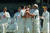 November 4th 2017, WACA Ground, Perth Australia; International cricket tour, Western Australia versus England, day 1; Aaron Hardie gets mobbed by team mates after dismissing England captain Joe Root for 9