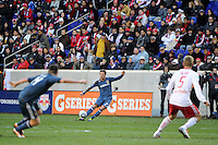 David Beckham (23) of the Los Angeles Galaxy passes to Robbie Keane (14) during the 1st leg of the Major League Soccer (MLS) Western Conference Semifinals against the New York Red Bulls at Red Bull Arena in Harrison, NJ, on October 30, 2011.