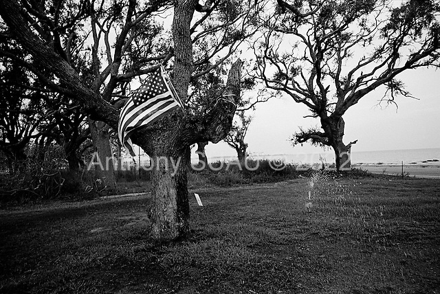 Long Beach, Mississippi.USA.July 30, 2006..A new lawn, a flag and a sprinkler are all that remain of a property after being hit by hurricane Katrina one year ago....