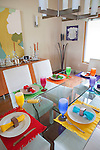 Colorful table setting  in a modern home, Sanford Lake, Michigan, MI, USA