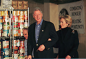United States President Bill Clinton and first lady Hillary Rodham Clinton enter the DC Central Kitchen to speak with homeless people in a food services training program December 21, 1998. Despite his impeachment President Clinton is enjoying some of the highest job approval ratings of his six years in office. Behind the President is U.S. Secretary of Agriculture Dan Glickman..Credit: Richard Ellis - Pool / CNP