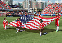 July 20, 2013: The flag kids hold the US flag during the opening ceremonies in a game between Toronto FC and the New York Red Bulls at BMO Field in Toronto, Ontario Canada.<br /> The game ended in a 0-0 draw.