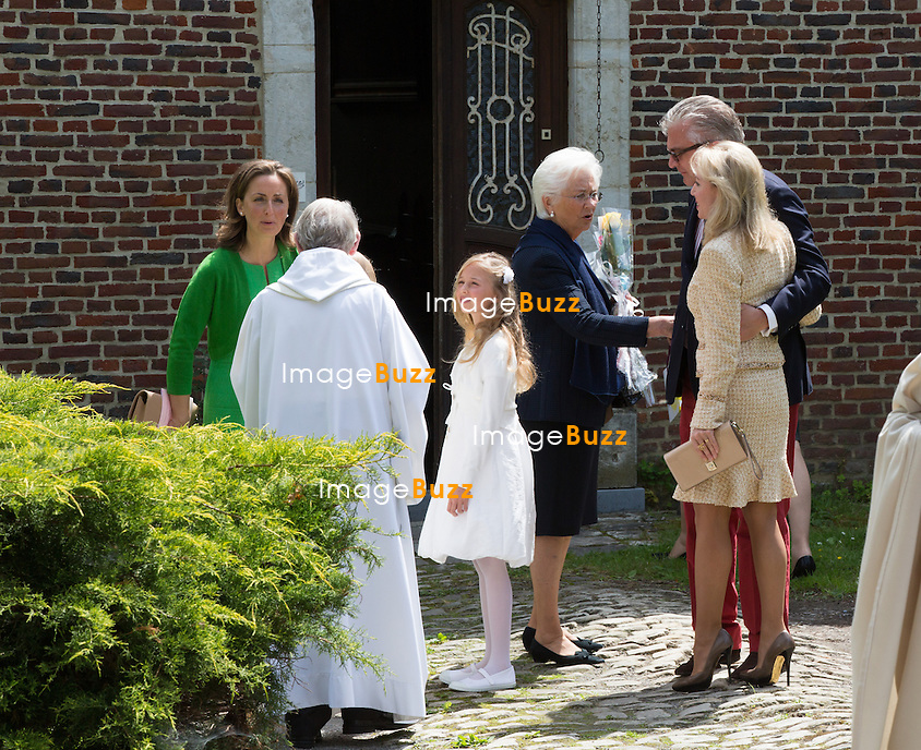 Princess Claire of Belgium, Queen Paola of Belgium, Prince Laurent of Belgium attend the first communion of twin princes Nicolas and Aymeric of Belgium, at the Sainte-Catherine church, in Bonlez, Belgium.<br /> 29 May 2014.