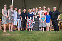 Patrons from Audi gather for a group photo.  Audi is the title-sponsor of the 2012 Chukkers for Charity Polo Match and Classic Car Show at Riverview Farm in Franklin, TN. Proceeds from this annual event benefit Rochelle Center and Saddle Up! Activities also include a silent auction, cabana decorating contest, half-time children's stickhorse race and patron's dinner.