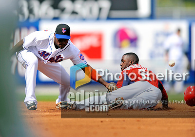28 February 2011: New York Mets infielder Luis Castillo is unable to hold a throw at second as Washington Nationals outfielder Roger Bernadina slides in safely during Spring Training action at Digital Domain Park in Port St. Lucie, Florida. The Nationals defeated the Mets 9-3 in Grapefruit League action. Mandatory Credit: Ed Wolfstein Photo